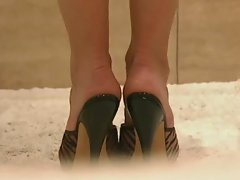 Doll putting high heels exposes peachy cunt