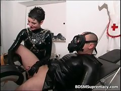Kinky dark haired hoe in latex blows penis