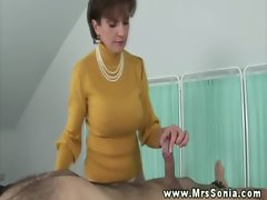 Attractive mature buxom hussy plays with penis