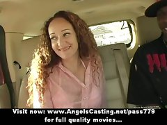 Sensuous slutty girl with long red hair does cock sucking for afro fellow in the car