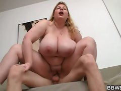 Huge lady is stroking and riding