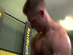 Hunky wrestler dominating greedy jock