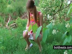 Beata pissing and stroking cucumber outside