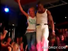 Afro filthy stripper dances with ladies at a sex party
