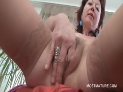 Attractive mature aroused young lady deep fingering her twat