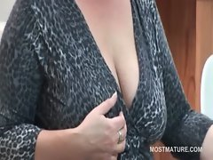 Office lady teasing her attractive mature knockers with a banana
