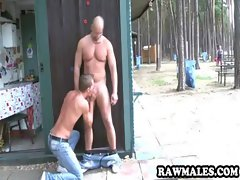Lewd stud getting his stiff penis stroked on in public