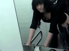 Raven-Haired Lassie Strokes & Screws In The WC