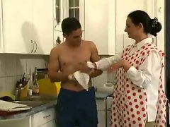 Bushy lactating attractive mature shagging with her toy fellow in the kitchen