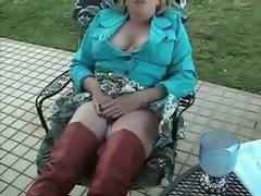 dirty wife admiring her toy in backyard - hubby films