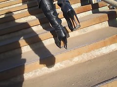 Lady in ebony leather boots and tan stockings going upstairs