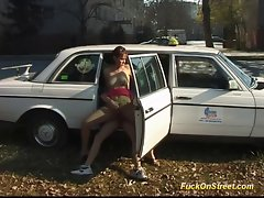 Filthy lady in full performance outdoor at my taxi car