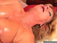 Grandma with big melons finger screws her oiled snatch