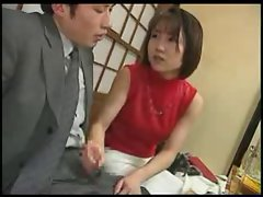 Jap wench gives a hand job during dinner