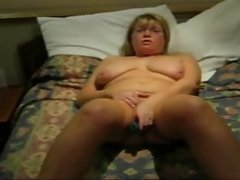 attractive mature granny plays with vibe