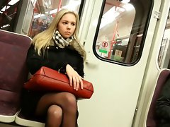 Light-haired Young lady in train with ebony pantyhose