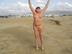Older hussy doing exercises in the dunes