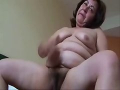 Experienced lecher hussy masturbating. Amateur elder
