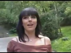 Dark haired babe serves pecker in a forest