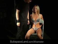 Restrained blondie slave dumped in a cage after bdsm usage