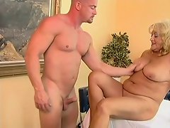 Big titted and plump granny banged by a bald guy.