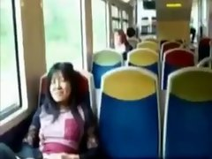 Asian mommy rubs her clit on a train.