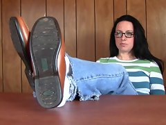 Penny brown loafer shoeplay on desk PREVIEW