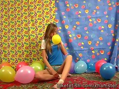 Sex partner Maya funny playing with balloons