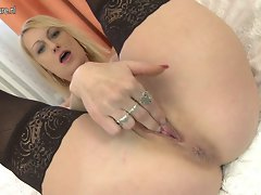 Filthy tempting blonde married woman playing with her rubber toy