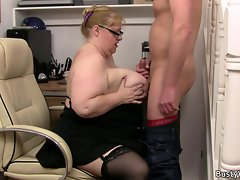 Heavy lady boss rides his prick