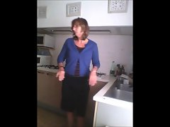 Spy Attractive mom in kitchen