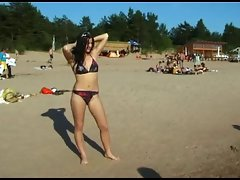 This luscious teen nudist strips bare at a public beach