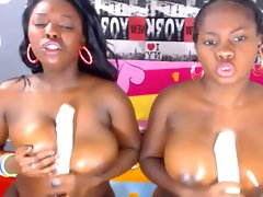 Two big titted filthy ebony webcam models: fake penis titfucking