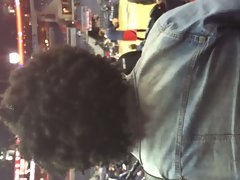 Attractive sensual ebony female with smoking filthy Afro hair