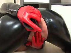 Blond cougar wearing latex toy muff