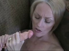 Attractive mom satisfies herself with a rubber toy