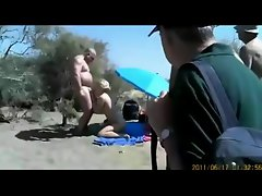 One Dirty wife and a lot of man's jerking off on naked beach