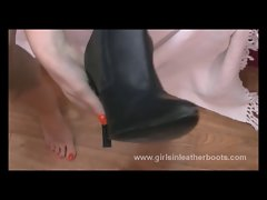 Sensual bare dark haired puts leather boots on for snatch play