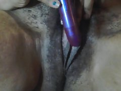 amature dark skin young lady cums playing with chaos vibrater.
