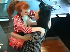 Redhead and Dark haired Eat And Play On Kitchen Counter