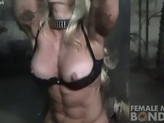 Woman Bodybuilder in Chains in the Dungeon