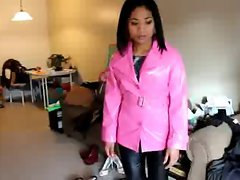 Asian in pinkish PVC coat and ebony leather pants