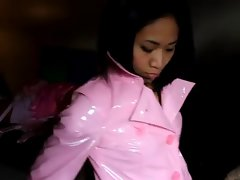 Asian in light pinky PVC jacket and pinky leather pants