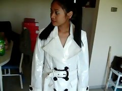 Asian in white PVC coat pants and boots