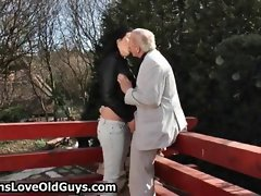 Grey senior gets his penis stroked