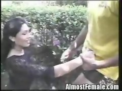 Asian Transsexual Gets Banged in Flower Garden