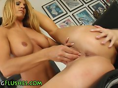 Lesbo fingers and fists her buxom friend