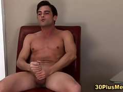 Muscular solo stud jerks his junk