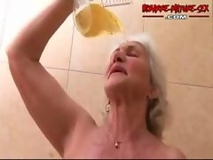 Granny loves to get banged by two dudes