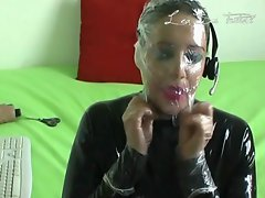 French lady in catsuit play with rubber toy on webcam